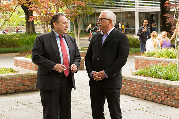 Freeman School Dean Ira Solomon, left, talks with Lepage prior to this year's Tulane Business Model Competition. Solomon says Lepage's gift has the potential to transform entrepreneurial education at the Freeman School.