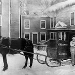 Delivering bread by horse-drawn sleigh, circa 1915.