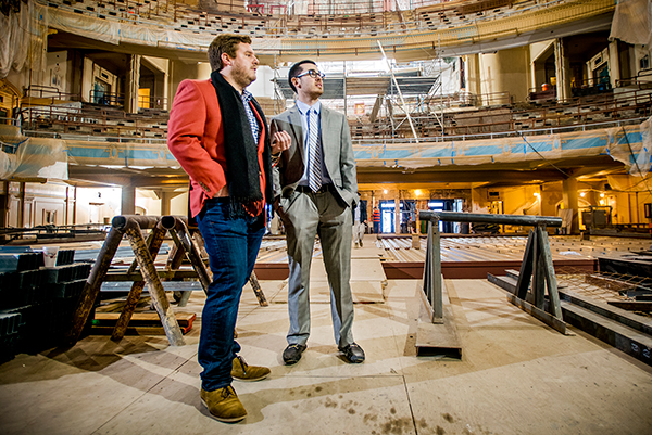 Barrett Cooper (MBA/13), left, give Freeman student Jason Dunleavy a tour of the Orpheum Theater, which his company is currently renovating.