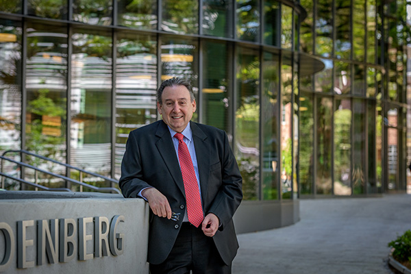 Ira Solomon in front of the Goldring/Woldenberg Business Complex