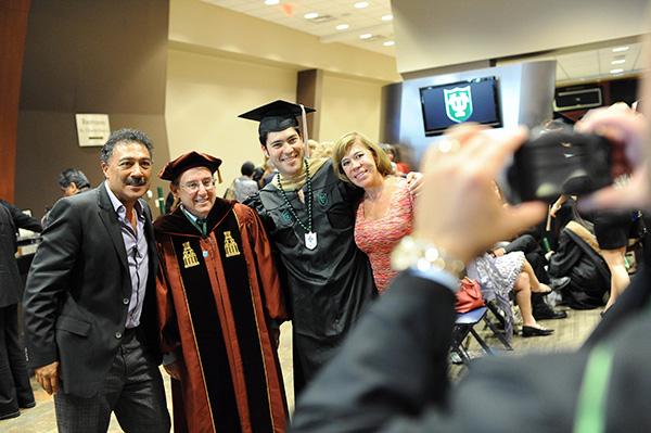 Dean Solomon with a new graduate